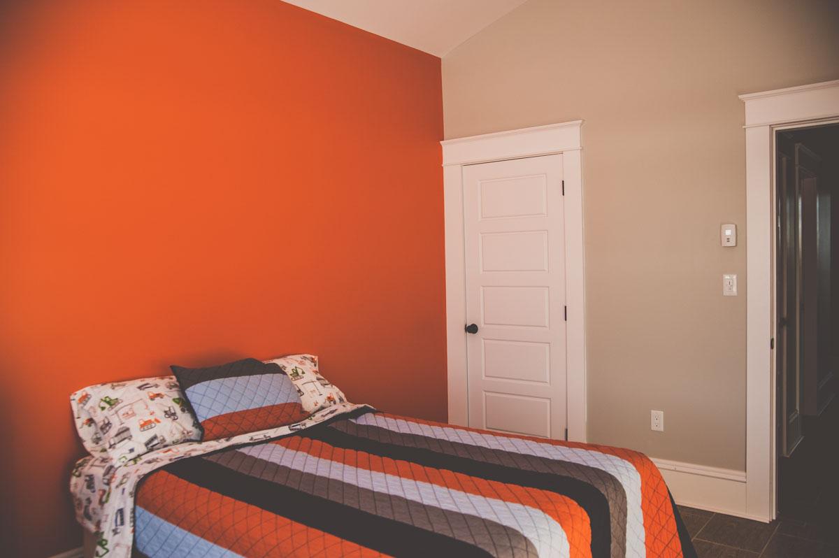 A spacious kid's bedroom in custom home.