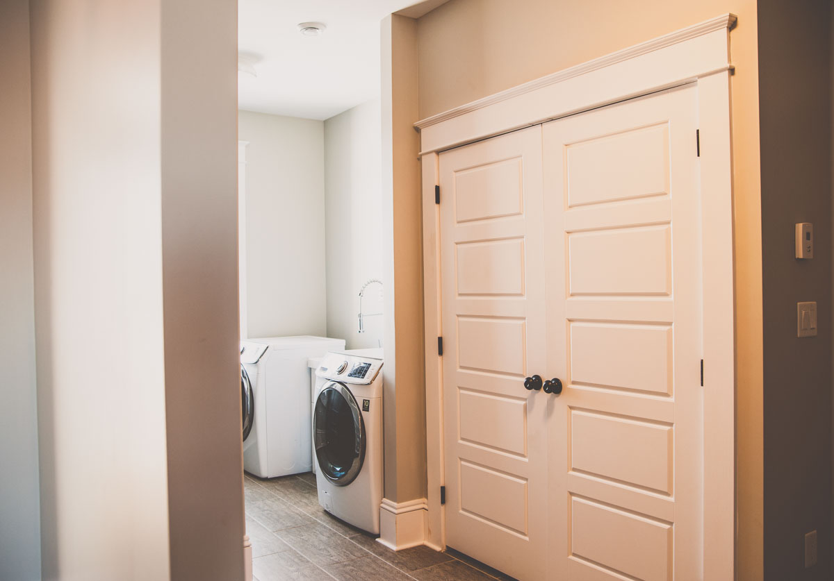 A spacious laundry room in Summerfield custom home