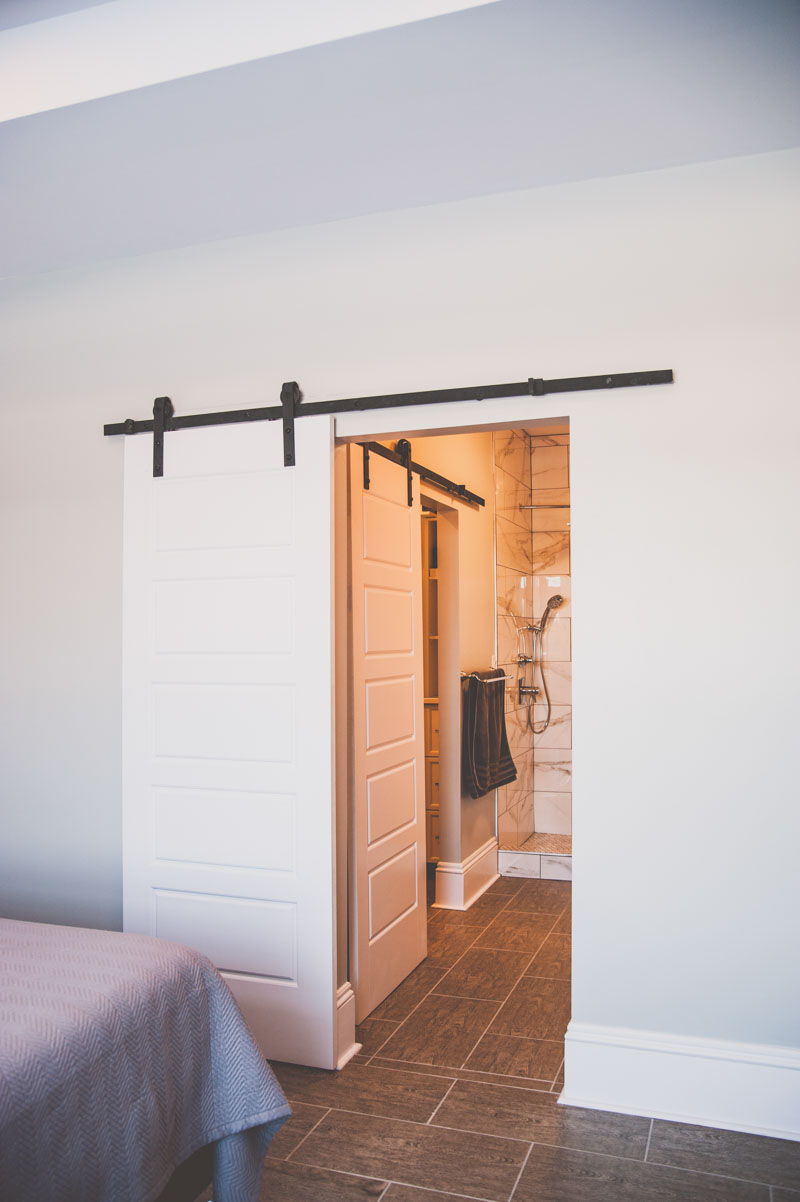 Barn doors separate the Master and Ensuite in this custom home