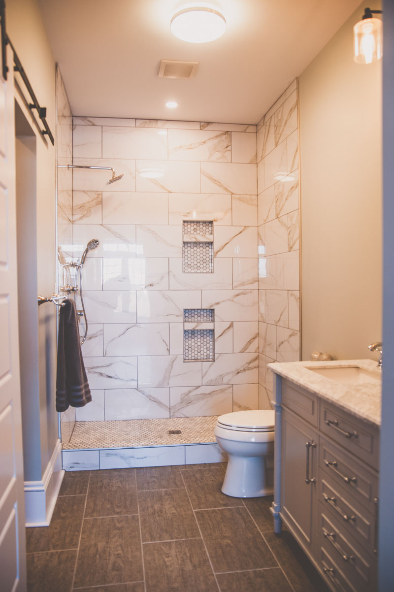 Ensuite bathroom with double vanity and custom tile shower